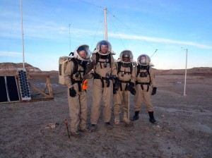 The intrepid EVA4 crew (Kiri, Mike, Luis, and Darrel) after raising the north antenna