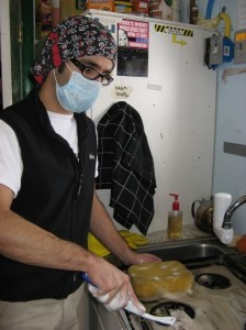 Luis cleaning the stovetop