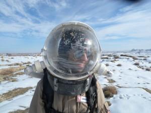 Luis with mud-spattered helmet
